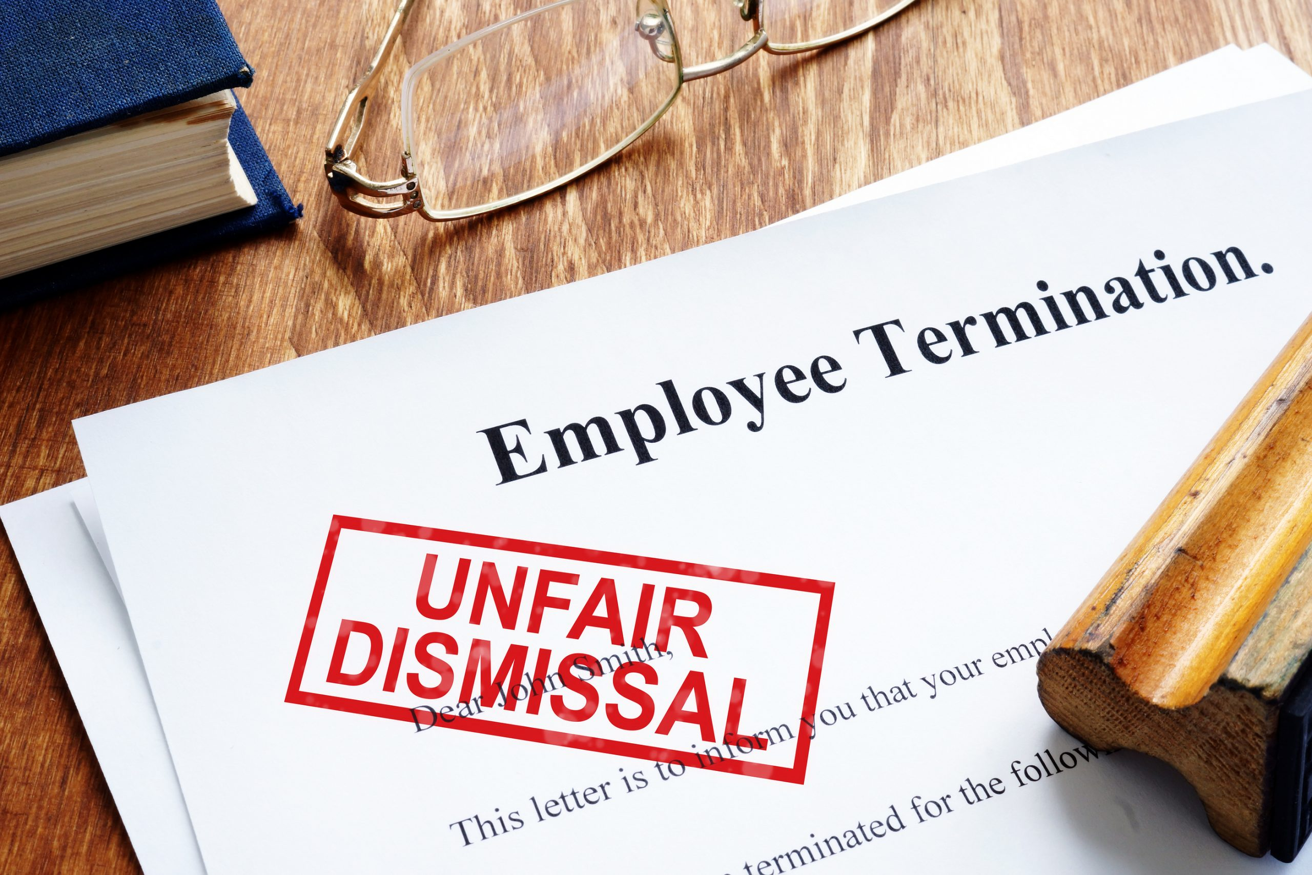 Picture of unfair dismissal stamped on termination paper