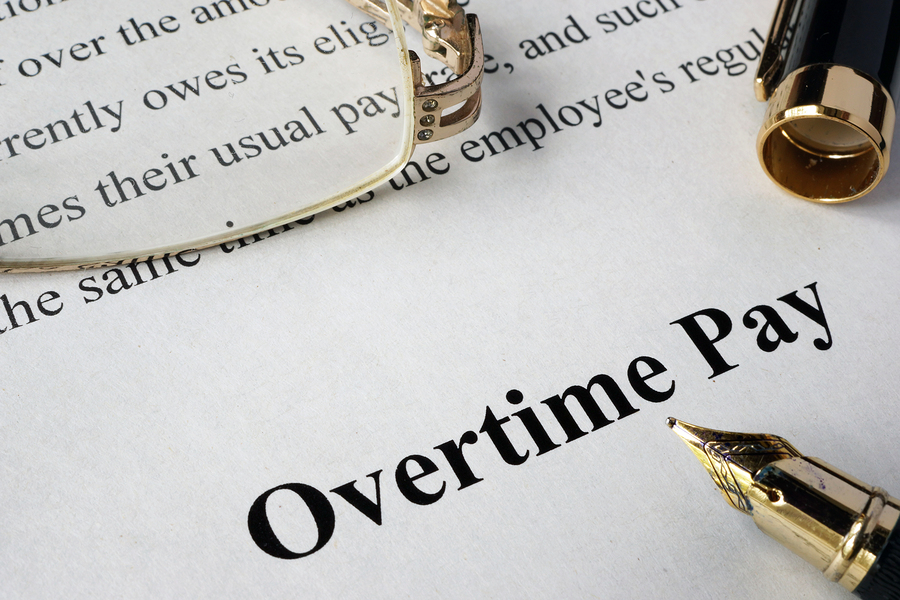 "Picture of ""overtime pay"" written on paper"